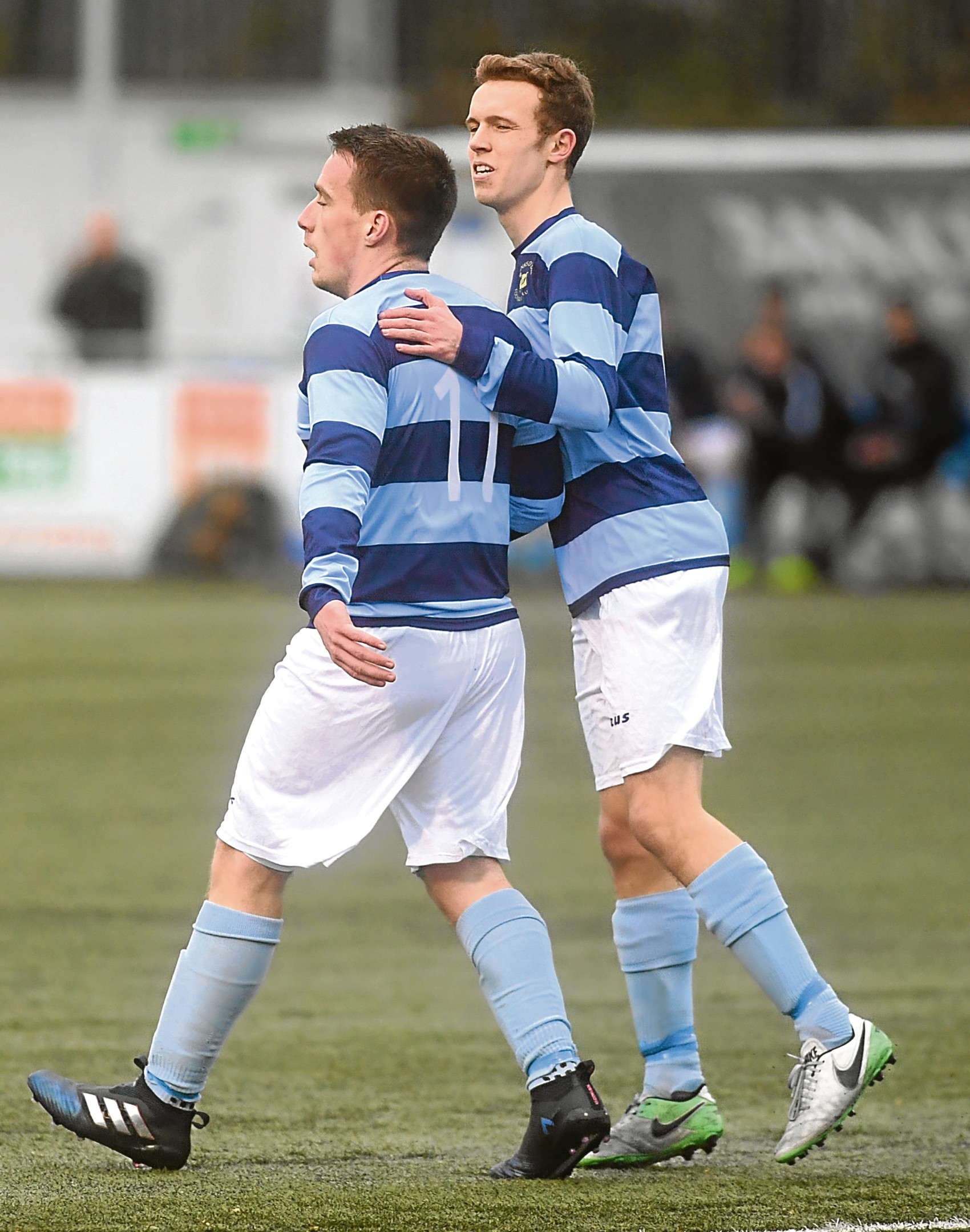 Dee's Jack Henderson, left, celebrates his first goal. Picture by Chris Sumner