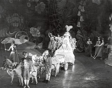 1955:  Coach and horses carry Cinderella to the ball.