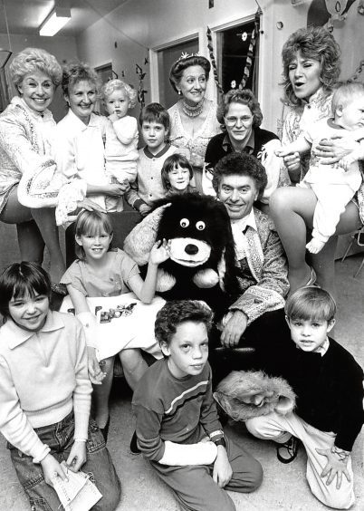 1987:Cast members of Cinderella pay a visit to the children at Royal Aberdeen Children's Hospital