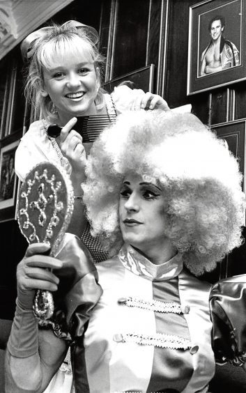 1988: Panto dame in Goldilocks, Wayne Sleep, has his wig touched up by Lisa Maxwell.