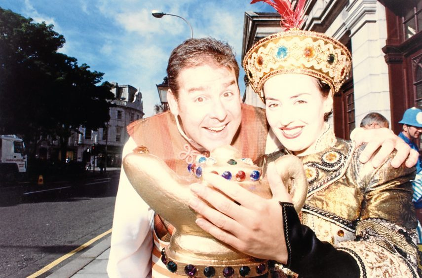 1997: Andy Gray as Wishee-Washee and Blue Peter presenter Romana D'Annunzio in Aladdin