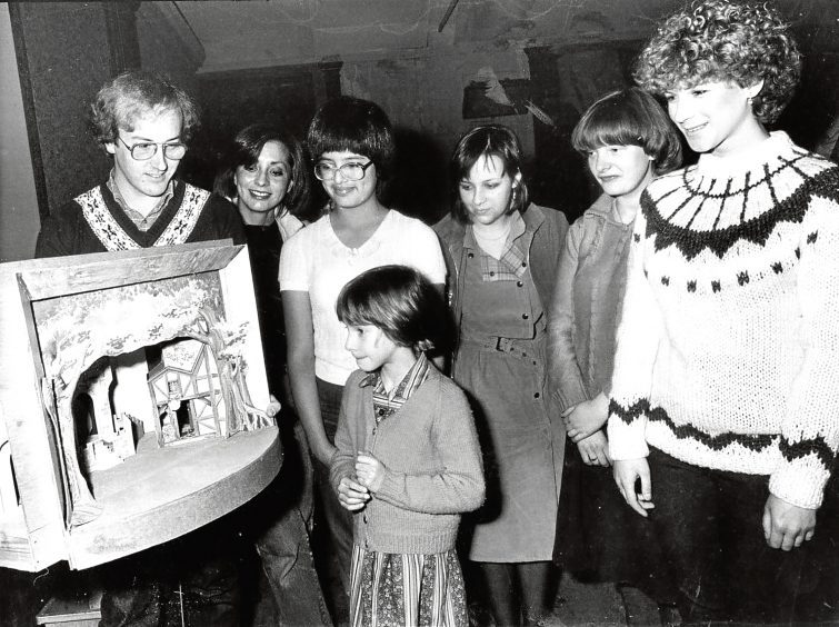 1981: Stage manager Douglas Shepherd shows a model of the Babes in the Wood set to some of the people at auditions.