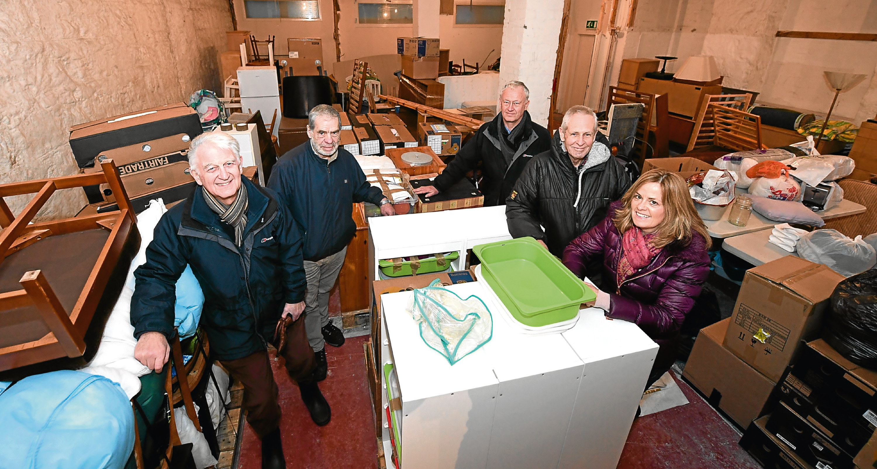 Rotairians have been collecting goods to be shipped off to Africa for a poverty project.     .....see story Jon Hebditch.       Pictured - L-R Jack Campbell, Sandy Lindsay, David Fryer, Alastair Brodie and Ishbel Sutherland.