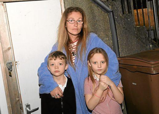 Jeannie McAllister with her children Zach and Abigail Joss.