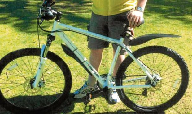 A Specialized Jynx model with a yellow frame and front suspension was taken from the property.