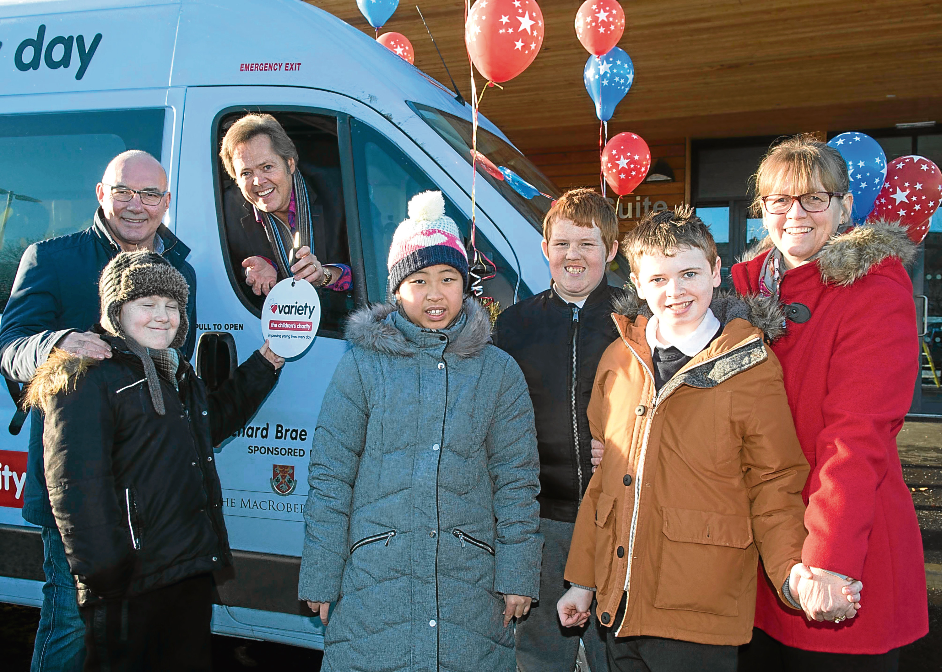 Admiring the new mini bus, from left, Willie Miller, Sean Grieve, Jimmy Osmond, Ella Chen, Stephen Brazendale, Harley White-Anderson and Orchard Brae head teacher Caroline Stirton.