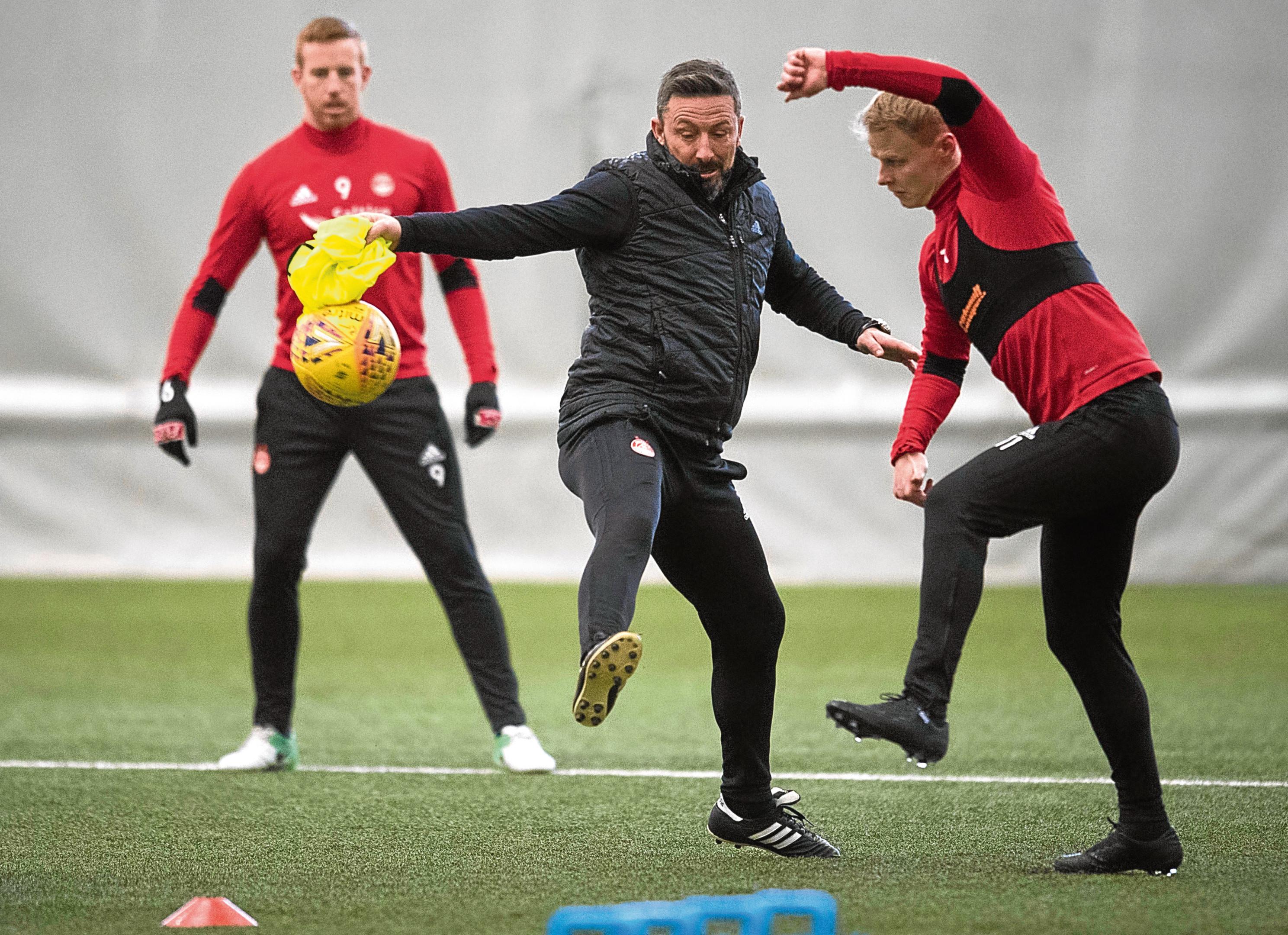 Derek McInnes joins in with training.