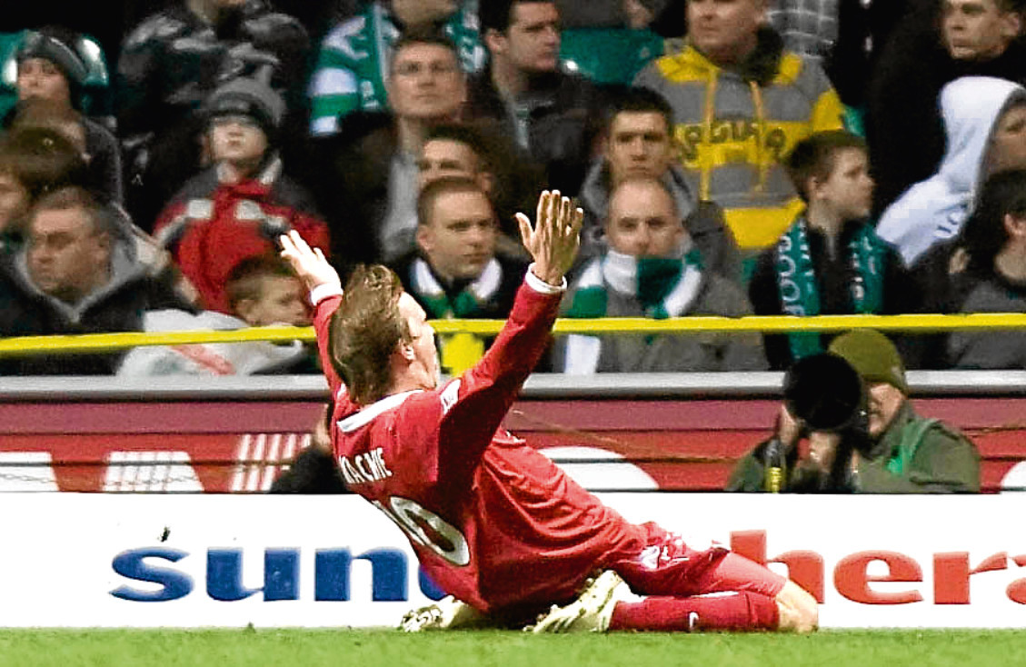 Aberdeen's Darren Mackie celebrates his goal in front of the Celtic fans in 2008.