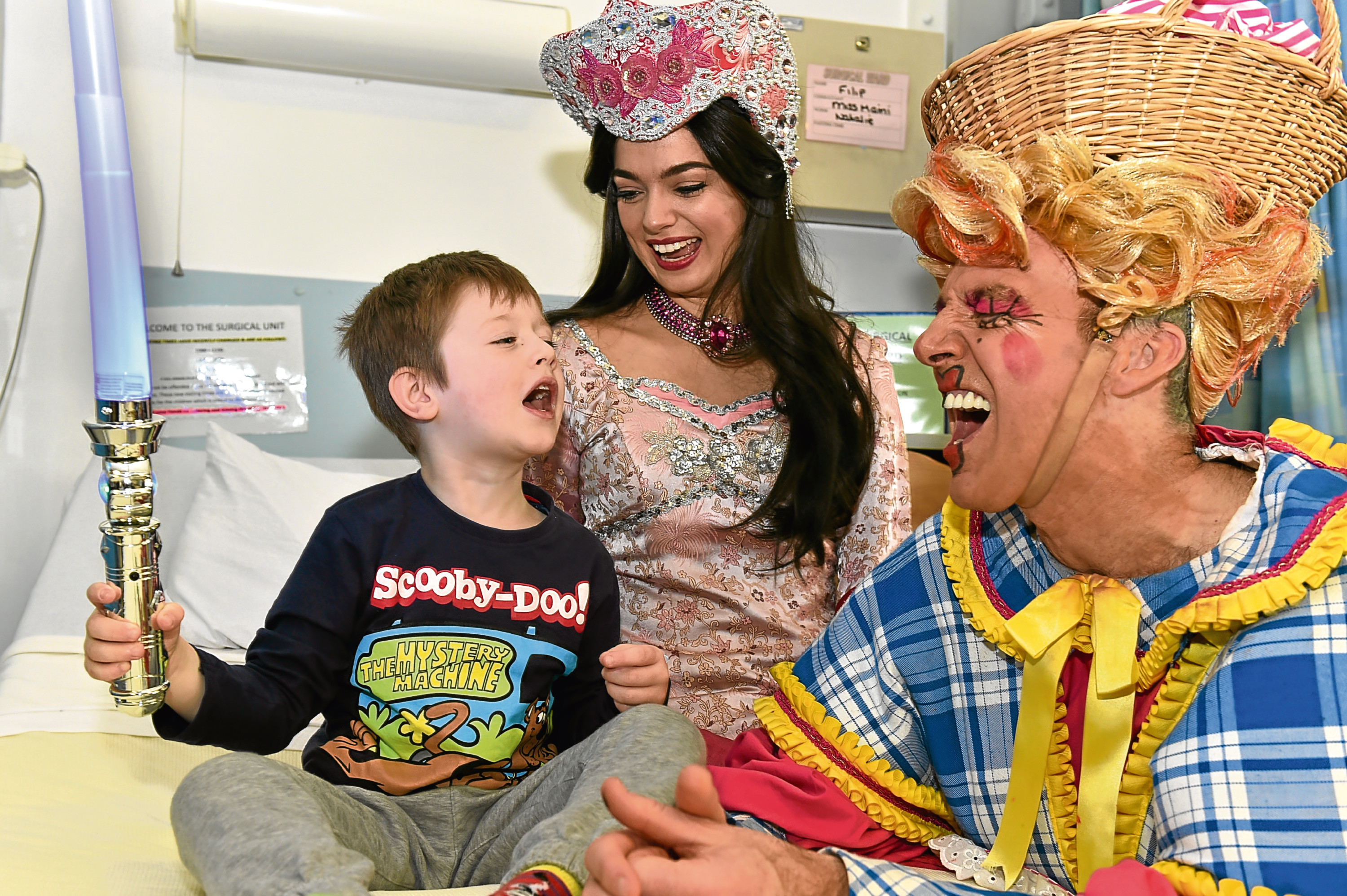 Some of the cast of HMT's panto Aladdin visited Aberdeen Children's Hospital to bring some cheer to the patients.  Filip , 5 with  (from left) Lisa-Anne Wood (Princess Jasmine) and Alan McHugh (Widow Twankey).