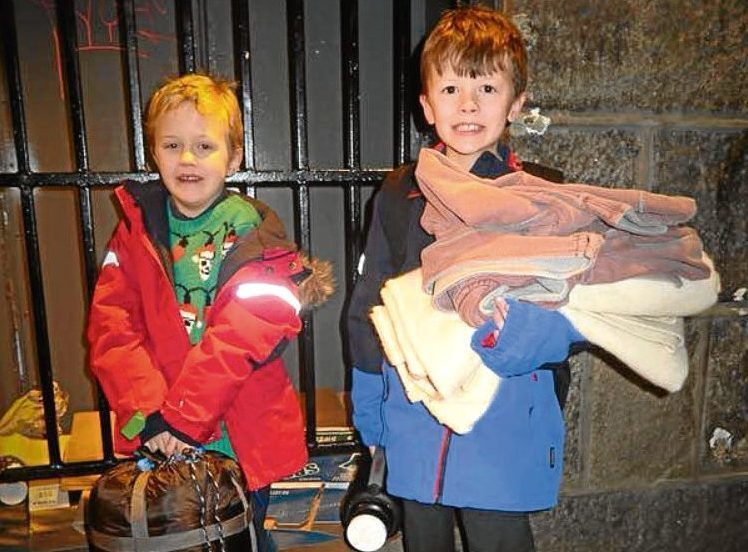 Brothers Ollie and Harry gave homeless people in the city centre soup and supplies.