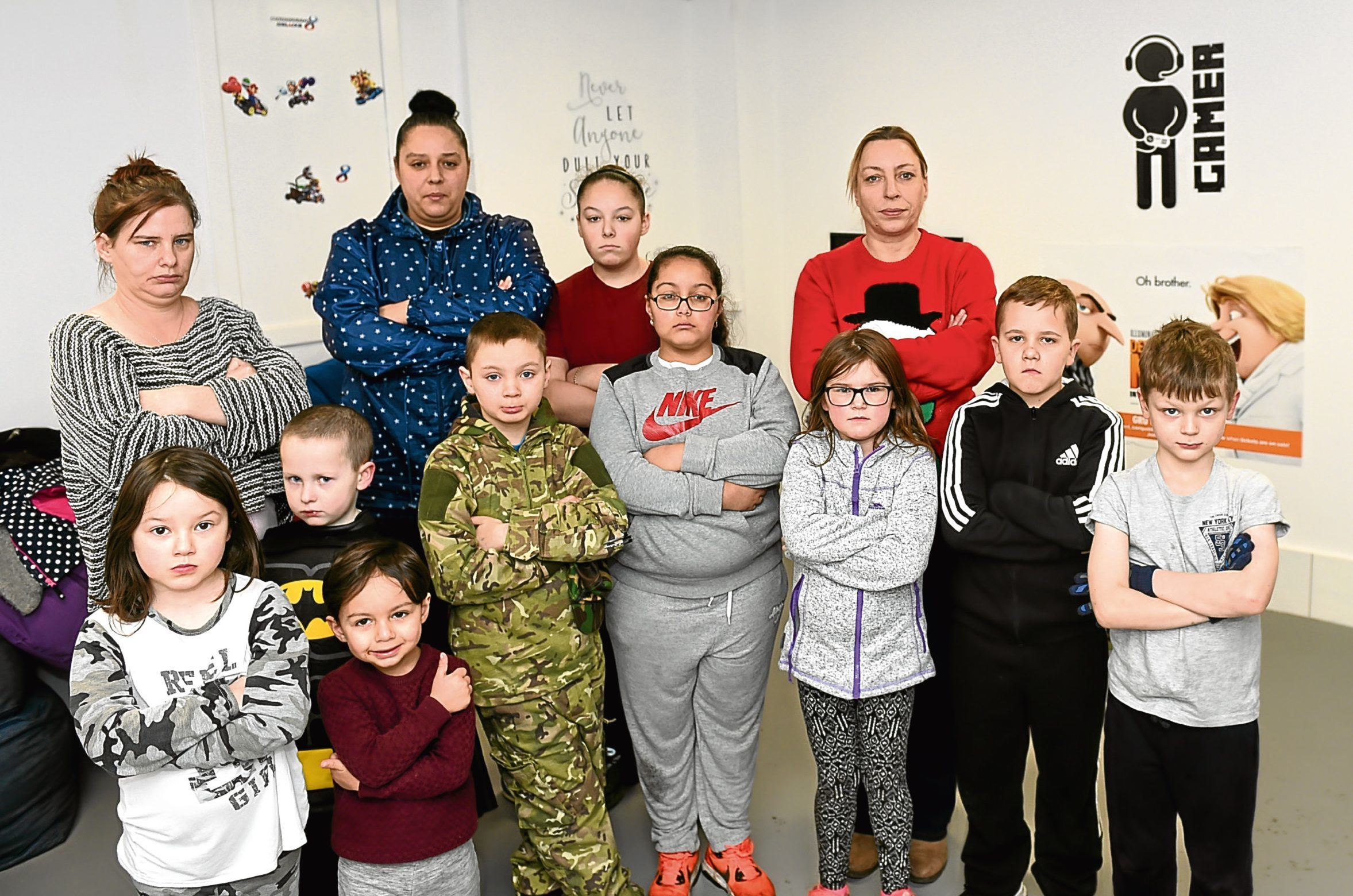 Staff and children in the games room at Powis Community Centre, Aberdeen.
