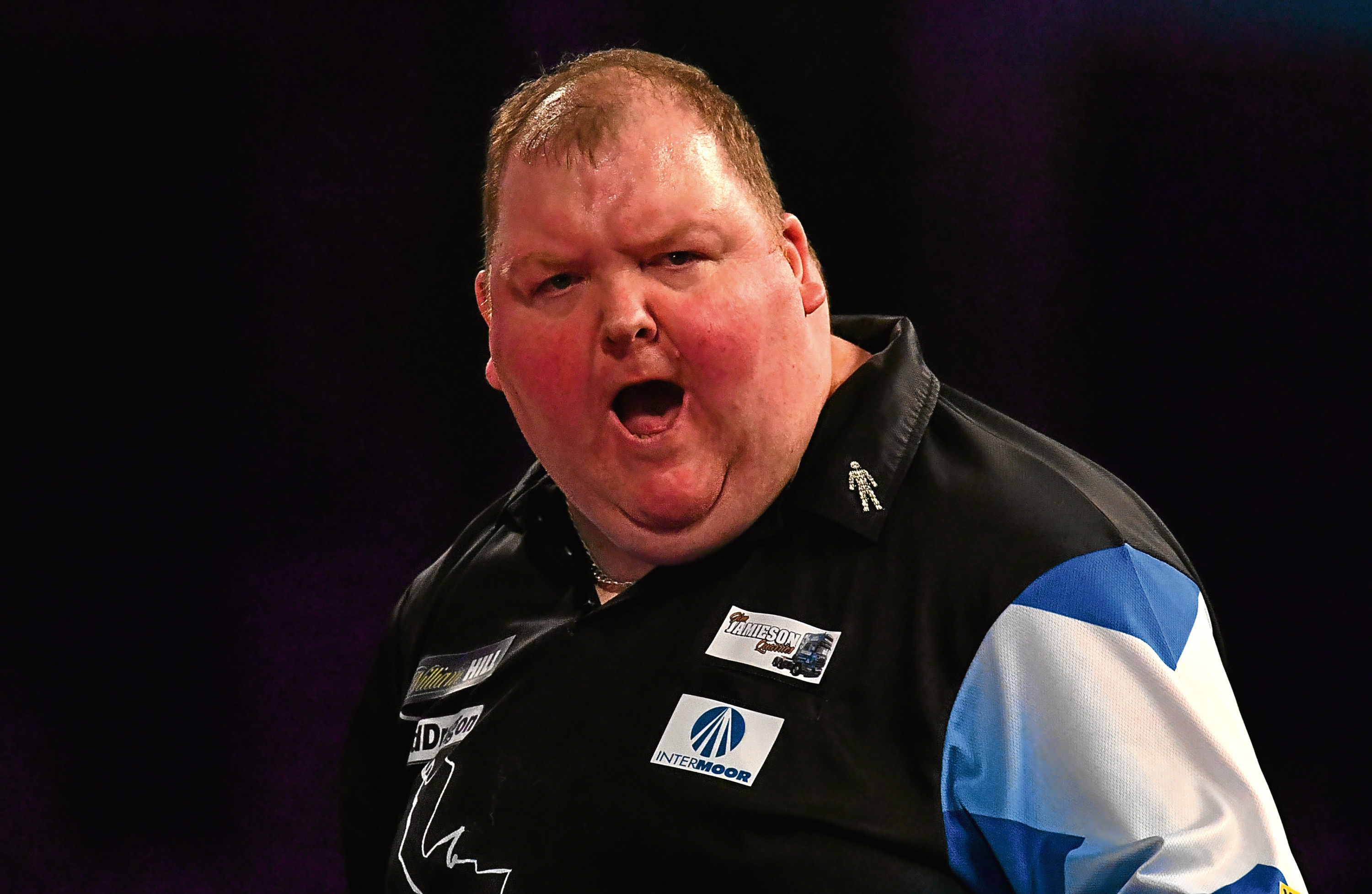 John Henderson reacts during his Third Round Match against Rob Cross.
