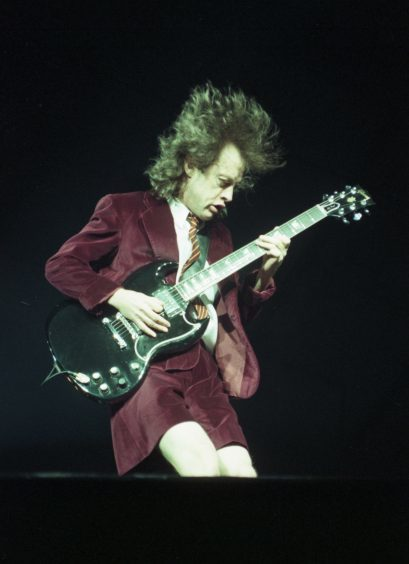1996: A power-charged performance... AC/DC lead guitarist Angus Young wows the crowd at  Aberdeen Exhibition and Conference Centre.