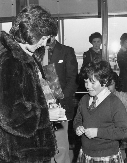 1978: 10-year-old Jennifer Milne of Cults got Cilla Black's autograph after the star arrived at Aberdeen Airport.