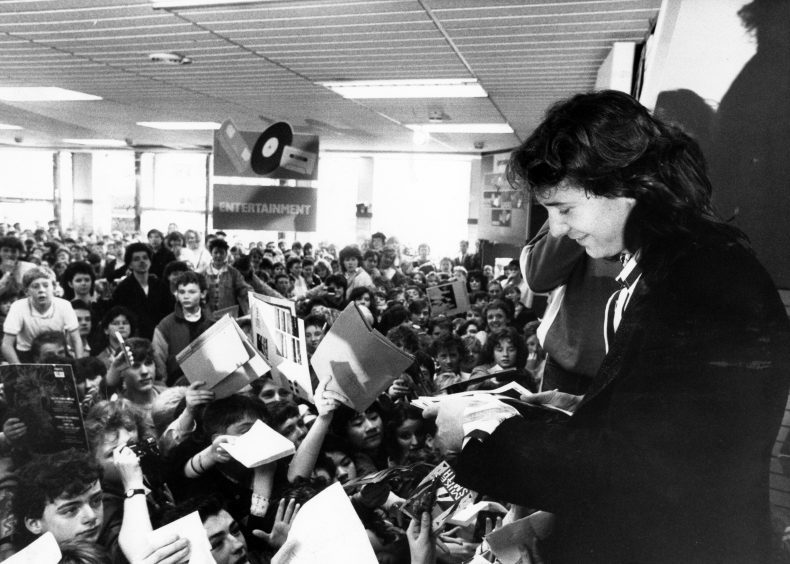1987: Simple Minds singer Jim Kerr signed autographs in Woolworths, Union Street, Aberdeen, as part of Radio One's week out.