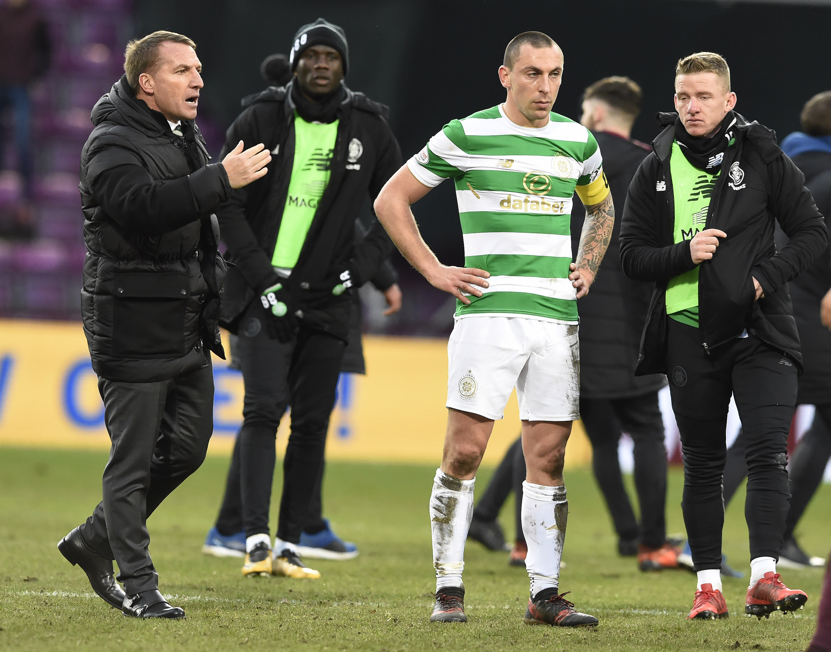 Celtic manager Brendan Rodgers and Scott Brown after the final whistle of the Ladbrokes Scottish Premiership match at Tynecastle.