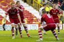 Aberdeen's Adam Rooney celebrates scoring against Dundee United the last time the two teams met at Pittodrie.