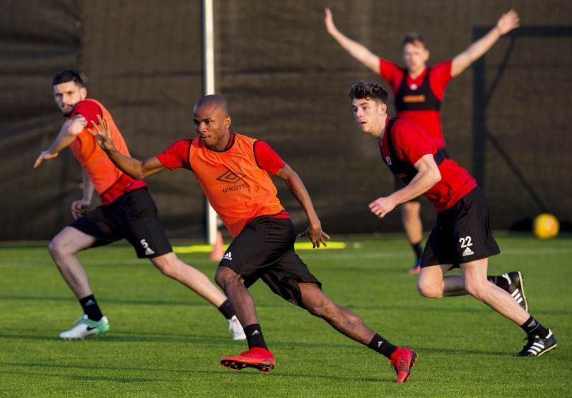 Aberdeen's Chidi Nwakali (L) and Ryan Christie at training.