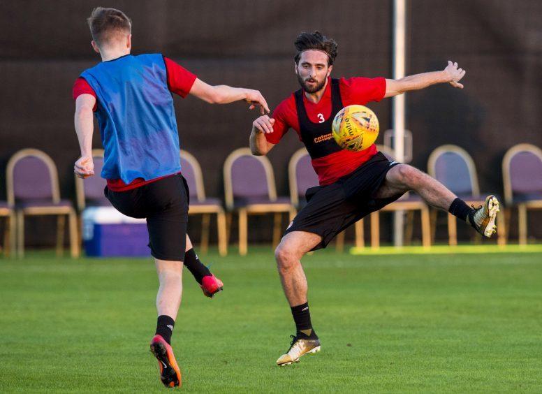 Aberdeen's Graeme Shinnie (R) at training.