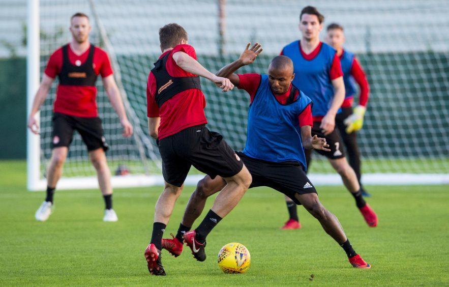 Aberdeen's Chidi Nwakali (R) at training.