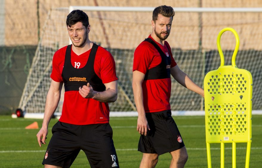 Aberdeen's Scott McKenna (L) and Kari Arnason training in Dubai.