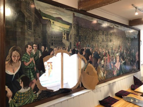 A large mural in the cafe was damaged in the break-in.