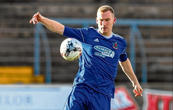 Cove Rangers' Eric Watson in action