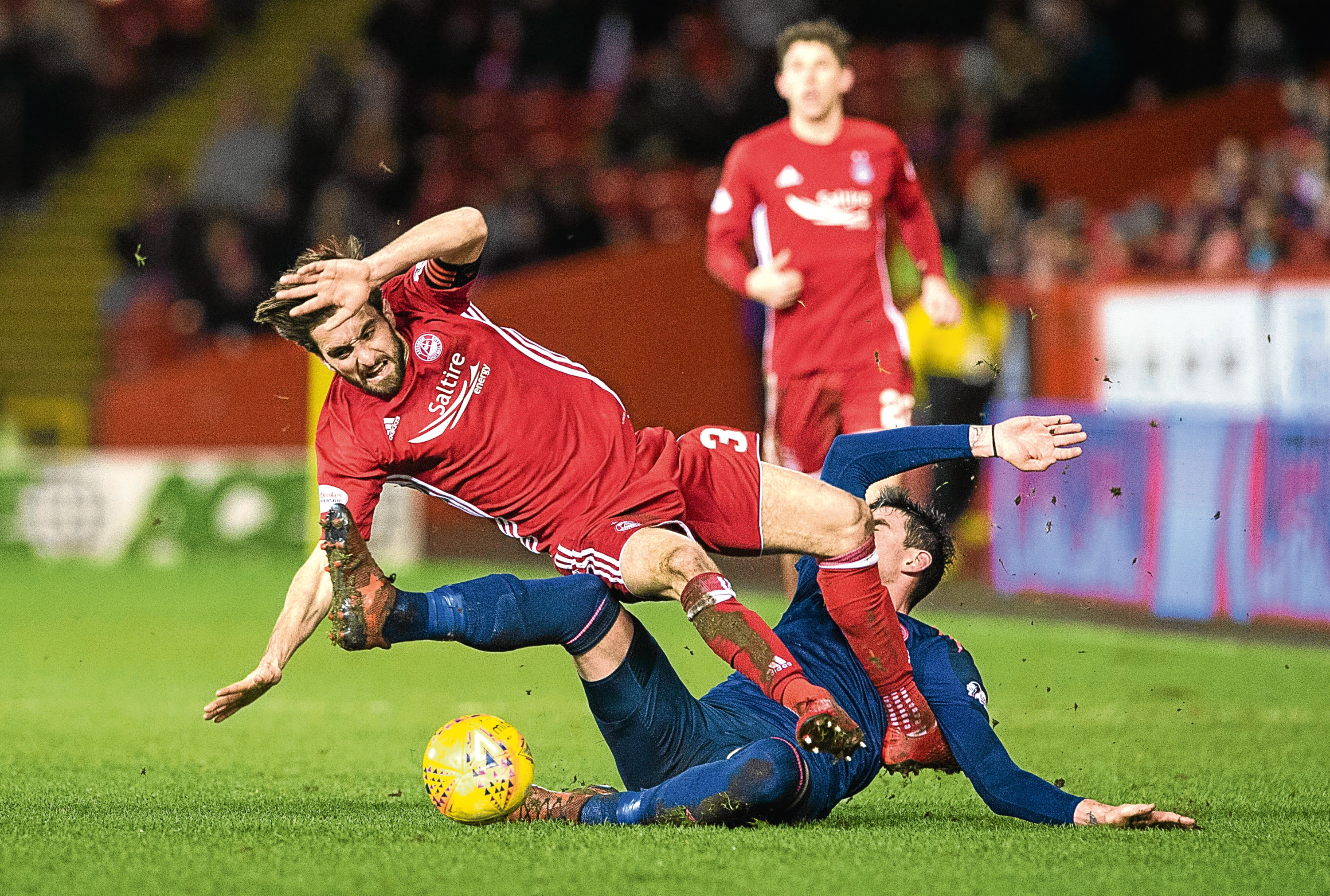 Aberdeen's Graeme Shinnie  is fouled by Kyle Lafferty who is sent off
