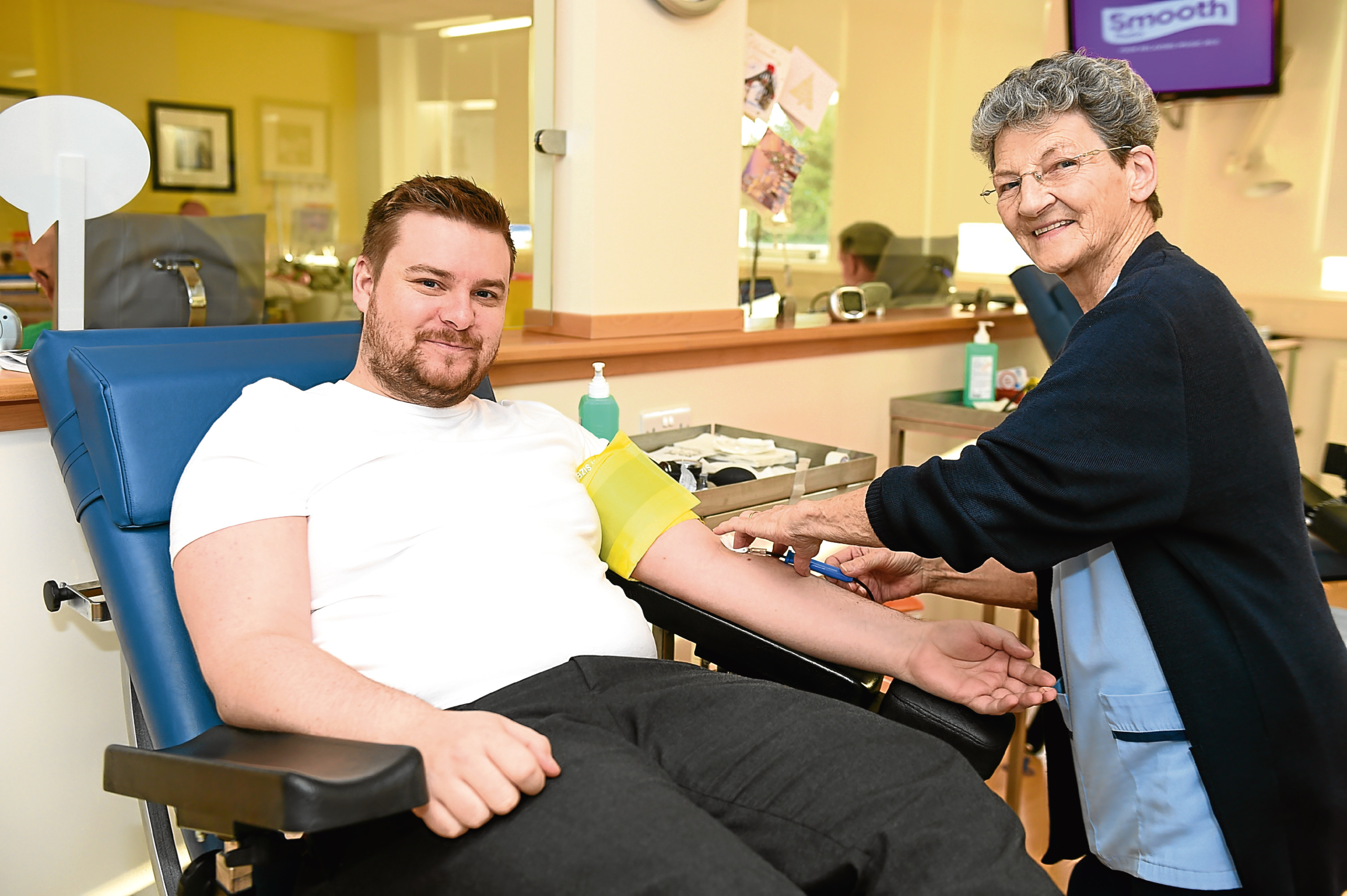 Callum Main with Evelyn Wood  at the blood donation centre.