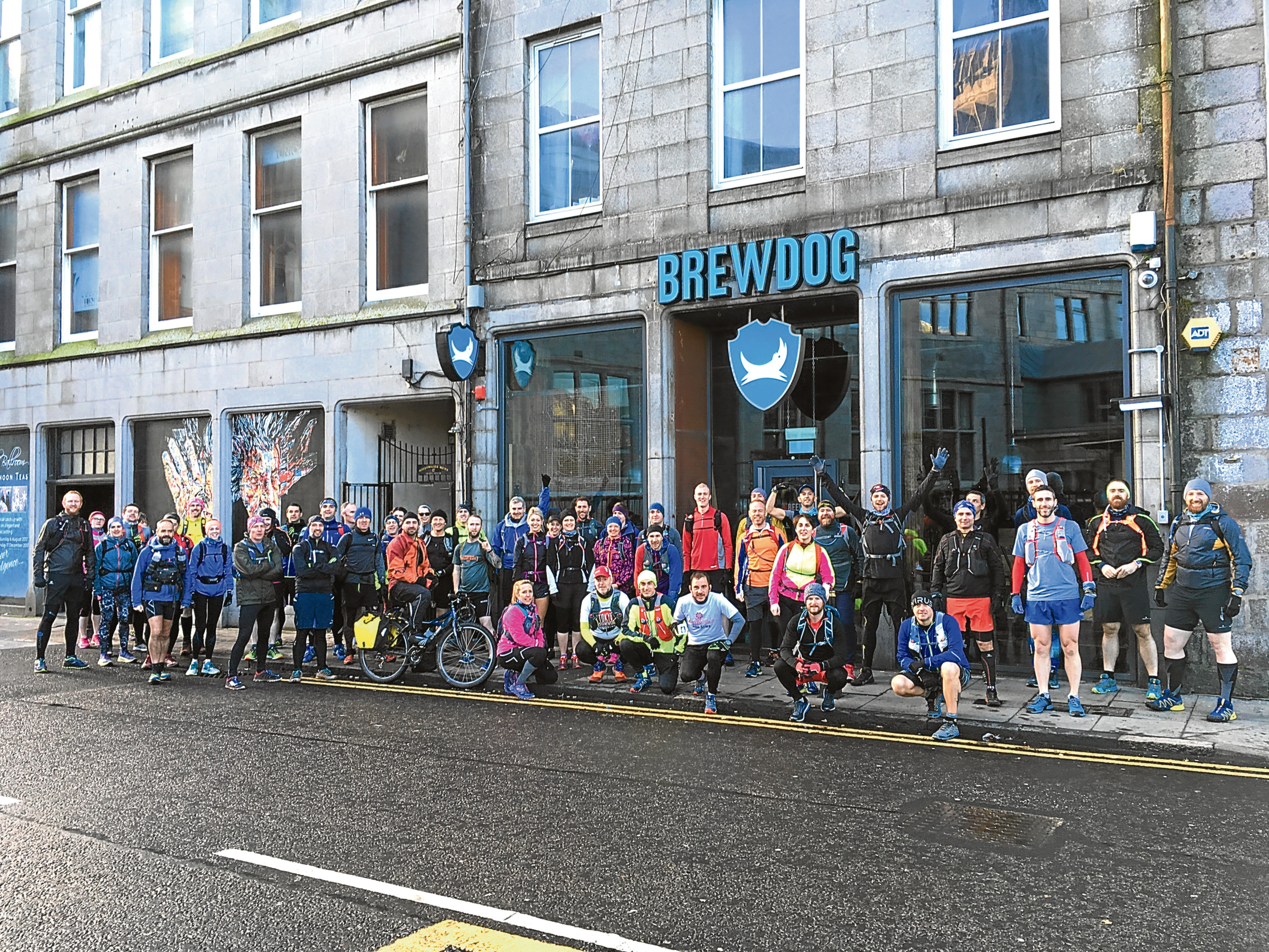 The walkers outside the BrewDog bar on Gallowgate.