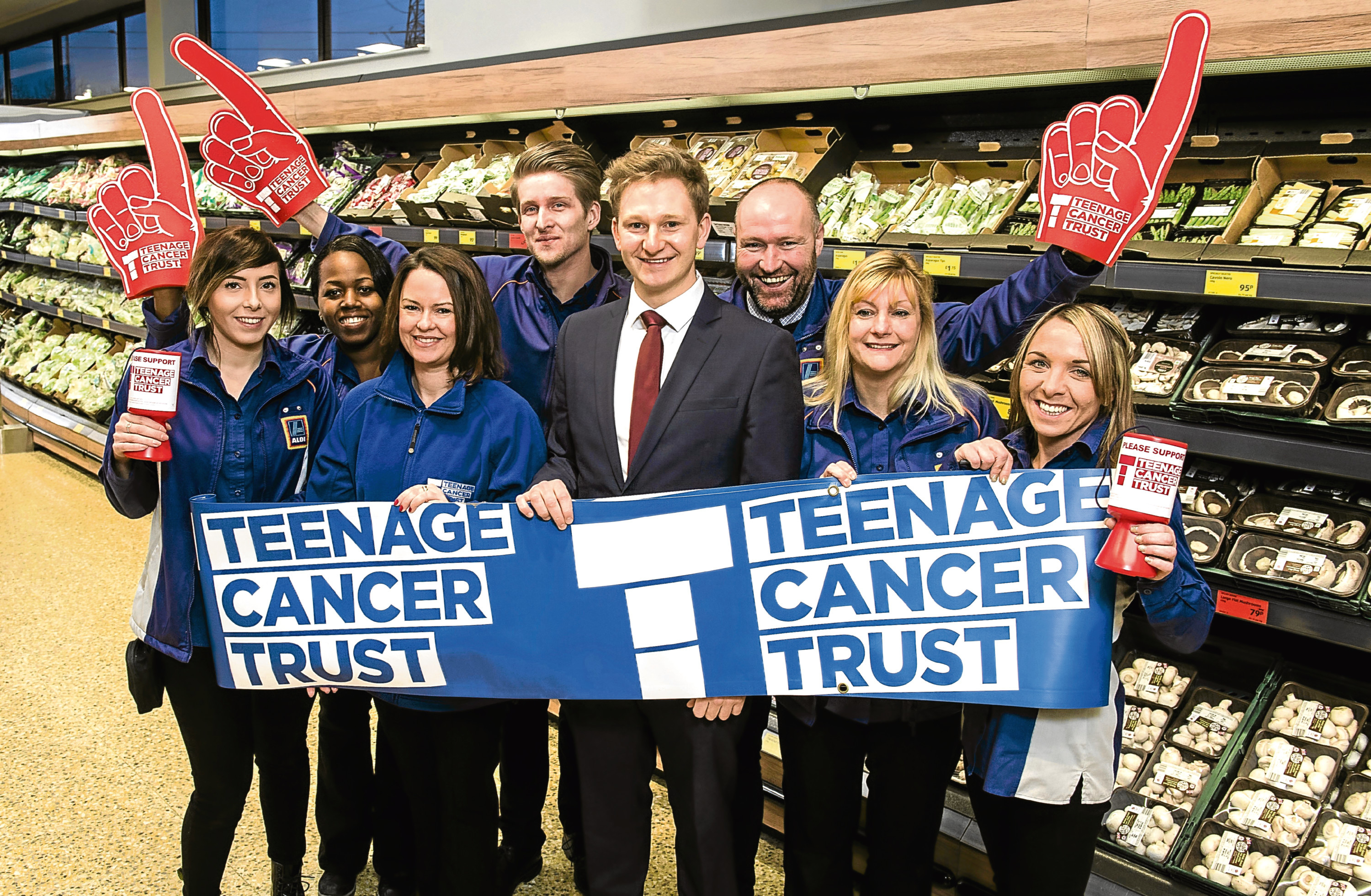 Pictured is employees of Aldi who have raised money for Teenage Cancer Trust. Kind-hearted customers and staff at Aldi's stores in Aberdeen have raised more than £1,400 for the Teenage Cancer Trust. picture submitted 12/01/2018