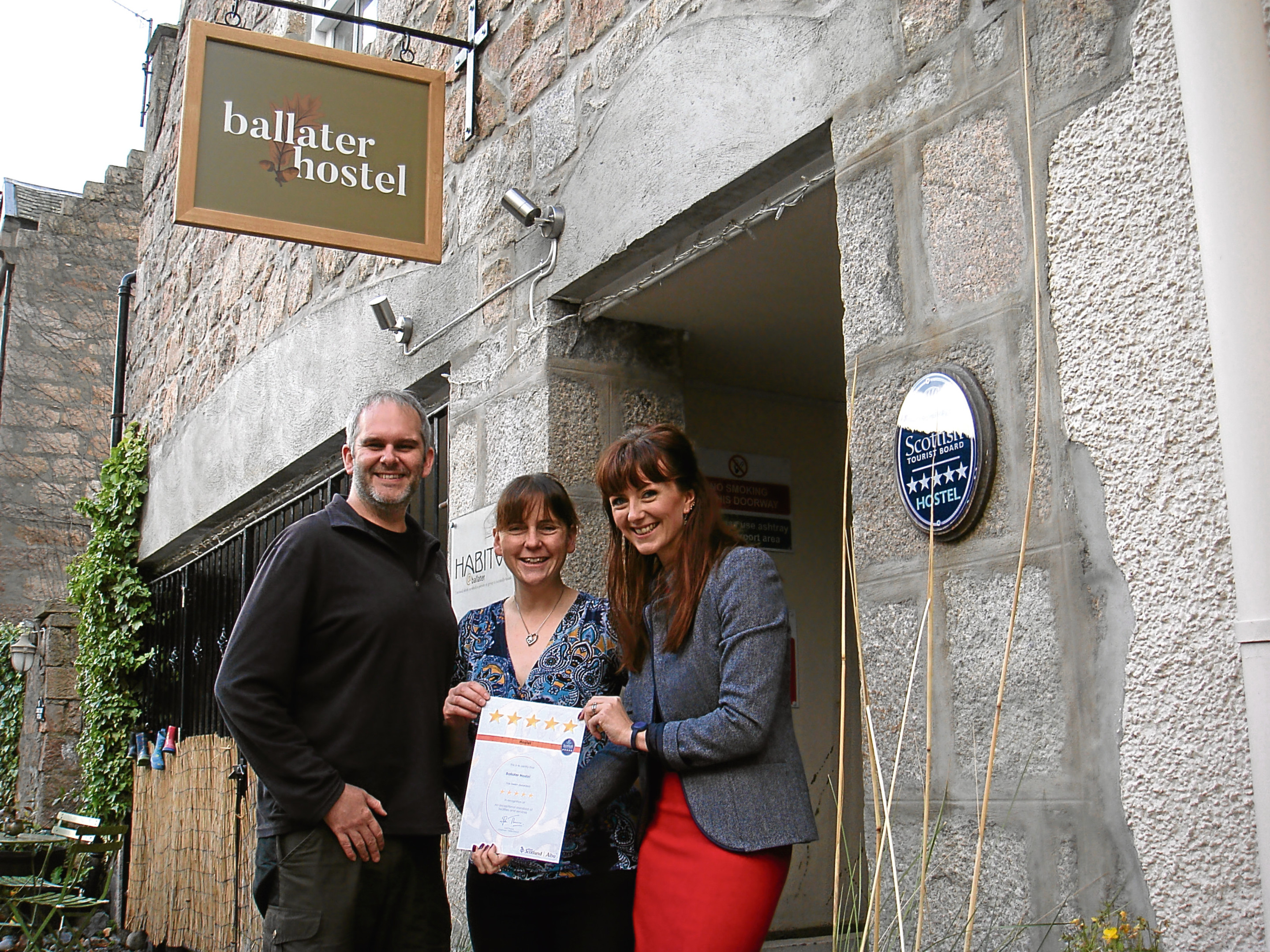 VisitScotland's Jo Robinson presents Daniel and Dominique Drewe-Martin with their certificate.