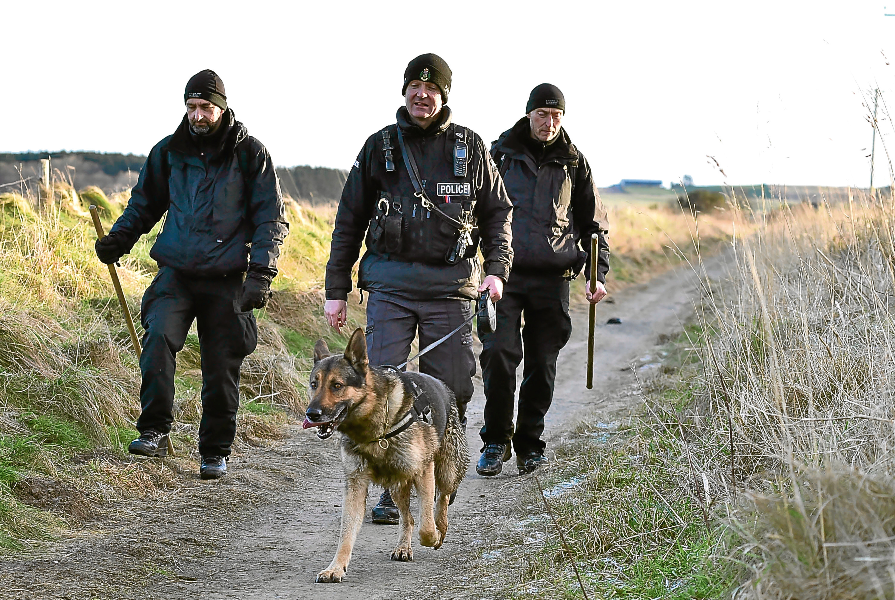 THE OLD  RAILWAY LINE BETWEEN FRASERBURGH AND STRICHEN IS SEARCHED BY POLICE AND DOGS.