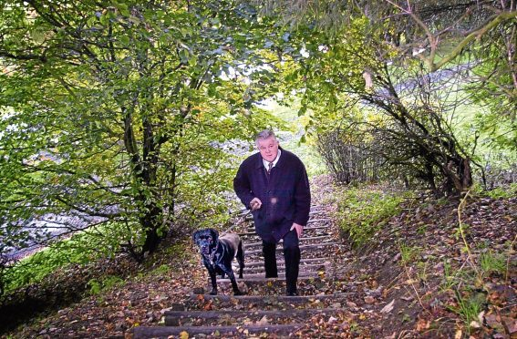 Former Grampian Country Food Group boss Mike Stephen with his dog Angus.