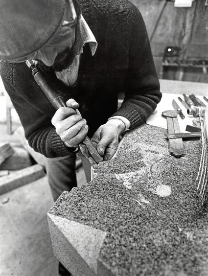 1975: Bill Elsey of A & J Robertson Ltd, Merkland Road, puts the final touches to a headstone