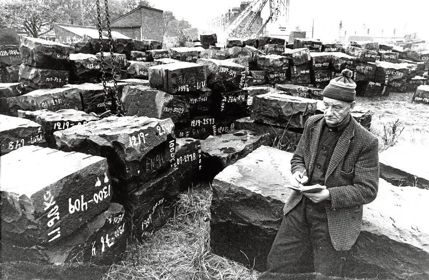 1980: A large consignment of black Swedish granite is checked by Henry Thompson, at Granite Supply Association's yard in Urquhart Road, Aberdeen.