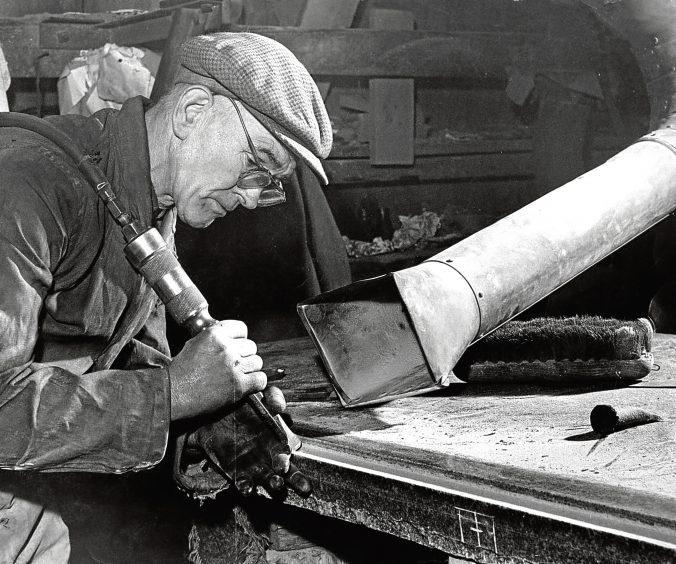 1966: John Steel carves an edge on granite fixing at the MacDonald's Yard, Aberdeen.