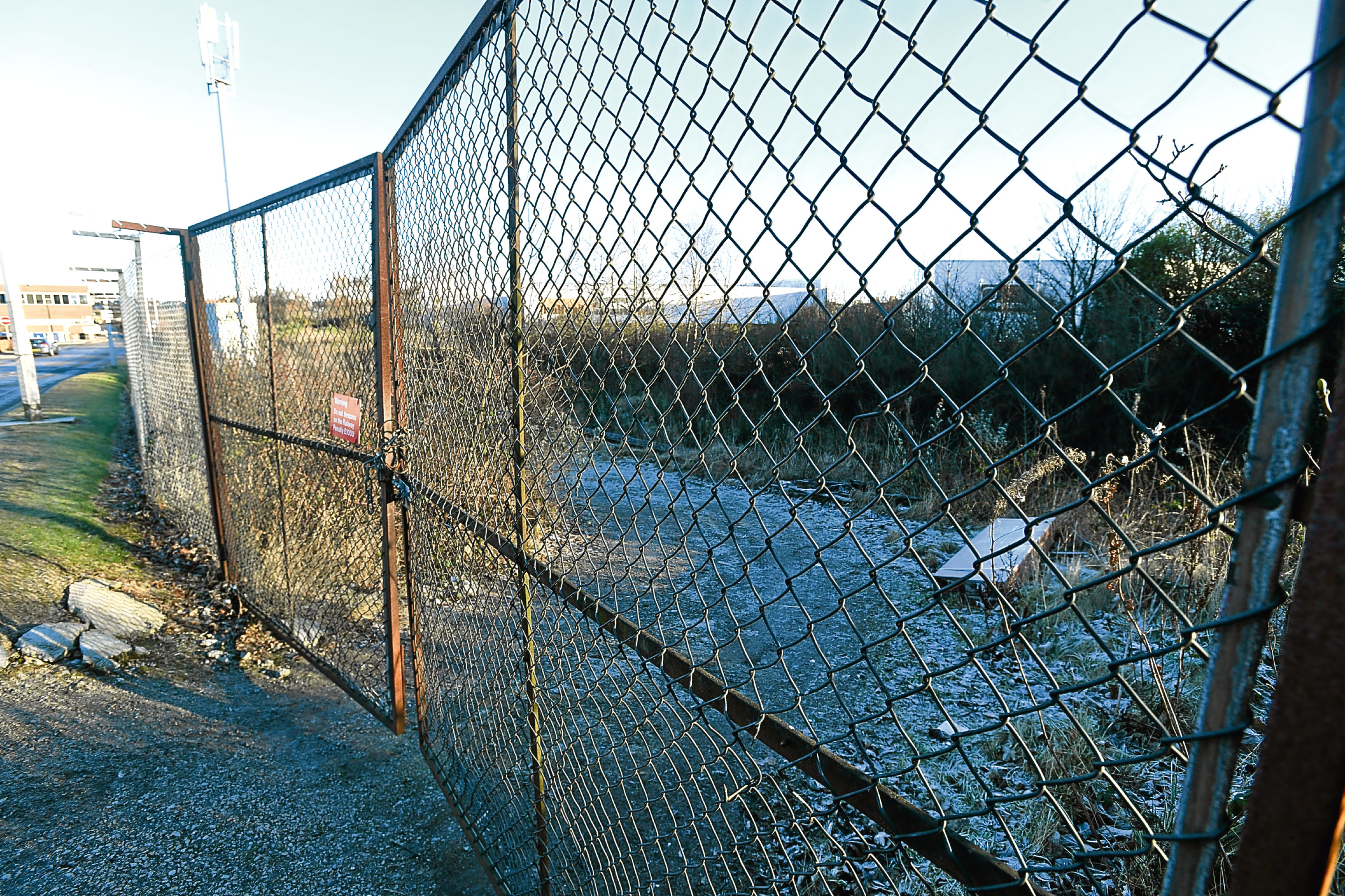 The fence barring access to the railway line near Kittybrewster Retail Park.