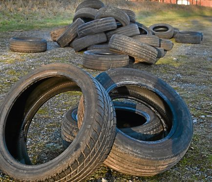 Tyres have been dumped in the church car park.
