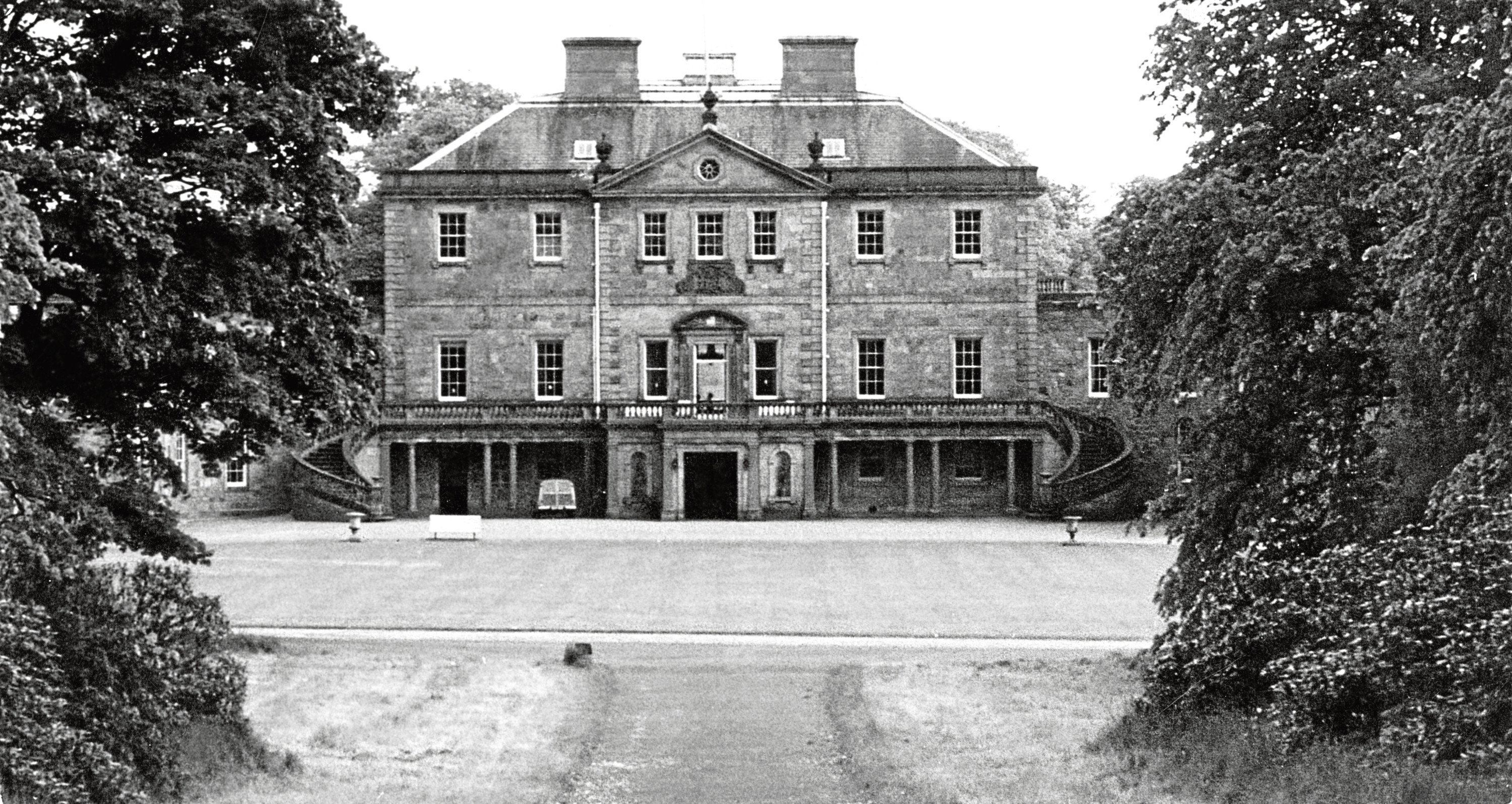 1961: An exterior view of the front entrance and gardens of Haddo House as seen in 1961.