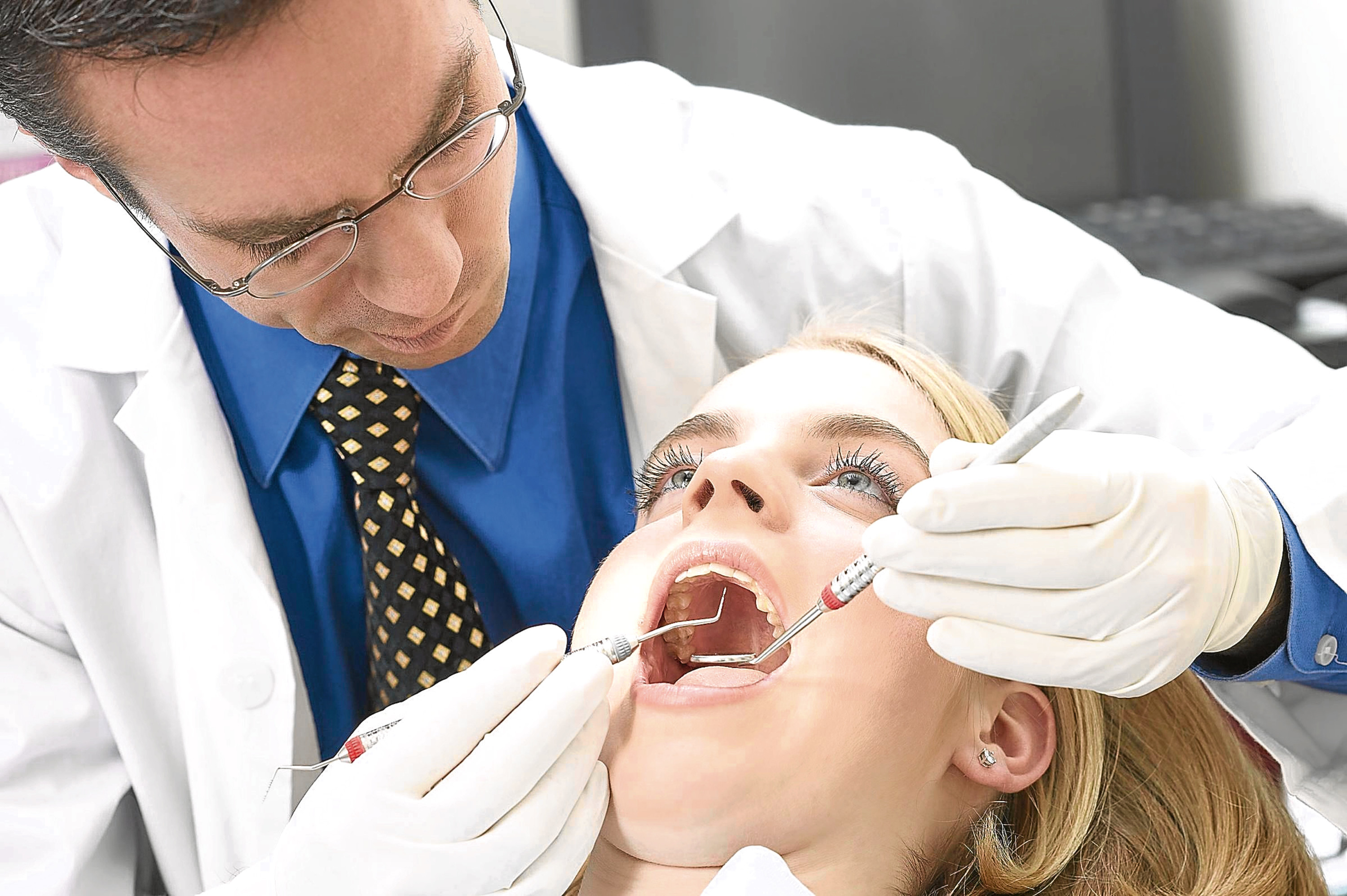 A Generic photo of a Dentist and patient.  See PA Feature HEALTH MOT. PA Photo/Generic
