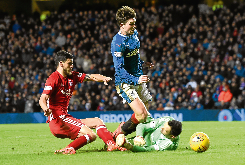 Rangers' Josh Windass is fouled by Aberdeen goalkeeper Joe Lewis as the home side win a penalty