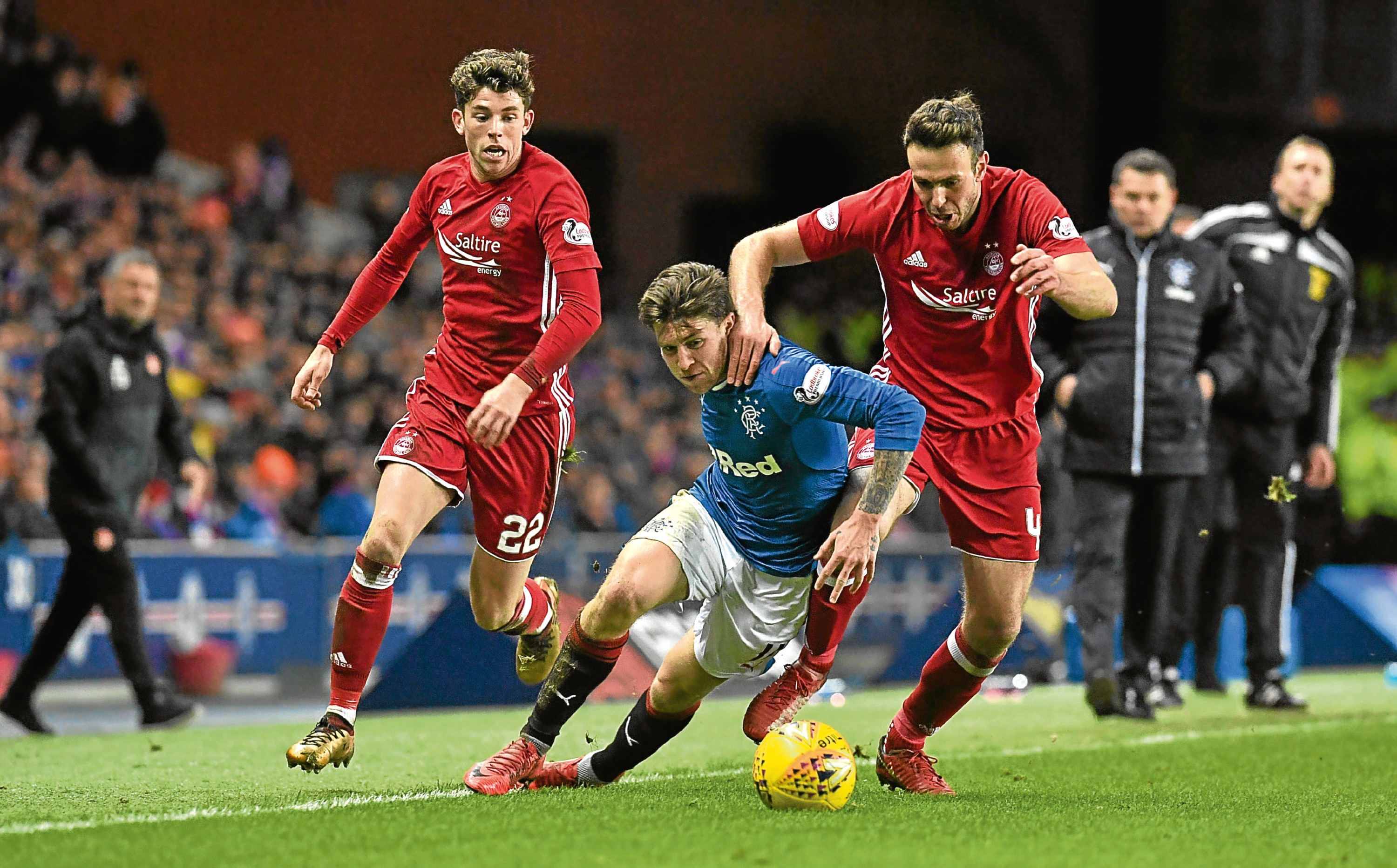 Rangers' Josh Windass (left) is fouled by in Aberdeen's Andrew Considine