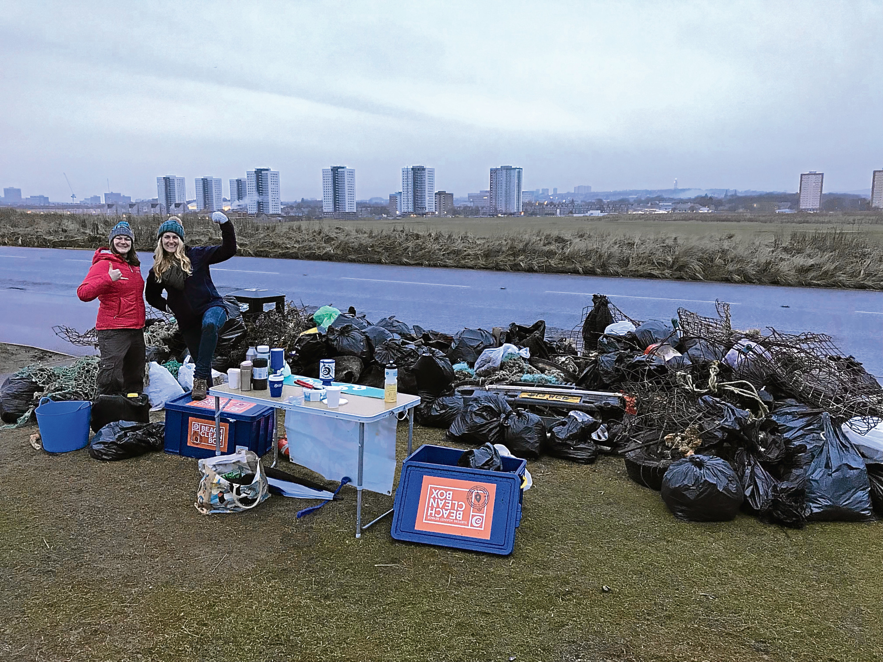 Lauren Smith, left, and one of the volunteers with some of the 500 bags of rubbish collected.