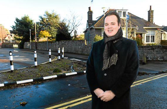 Councillor Alexander McLellan at the site.