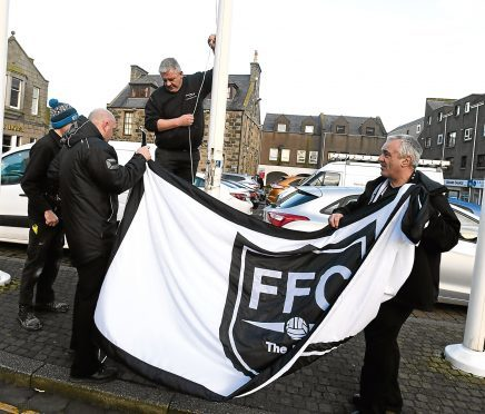 Fraserburgh FC's flag is raised aloft in the town centre.