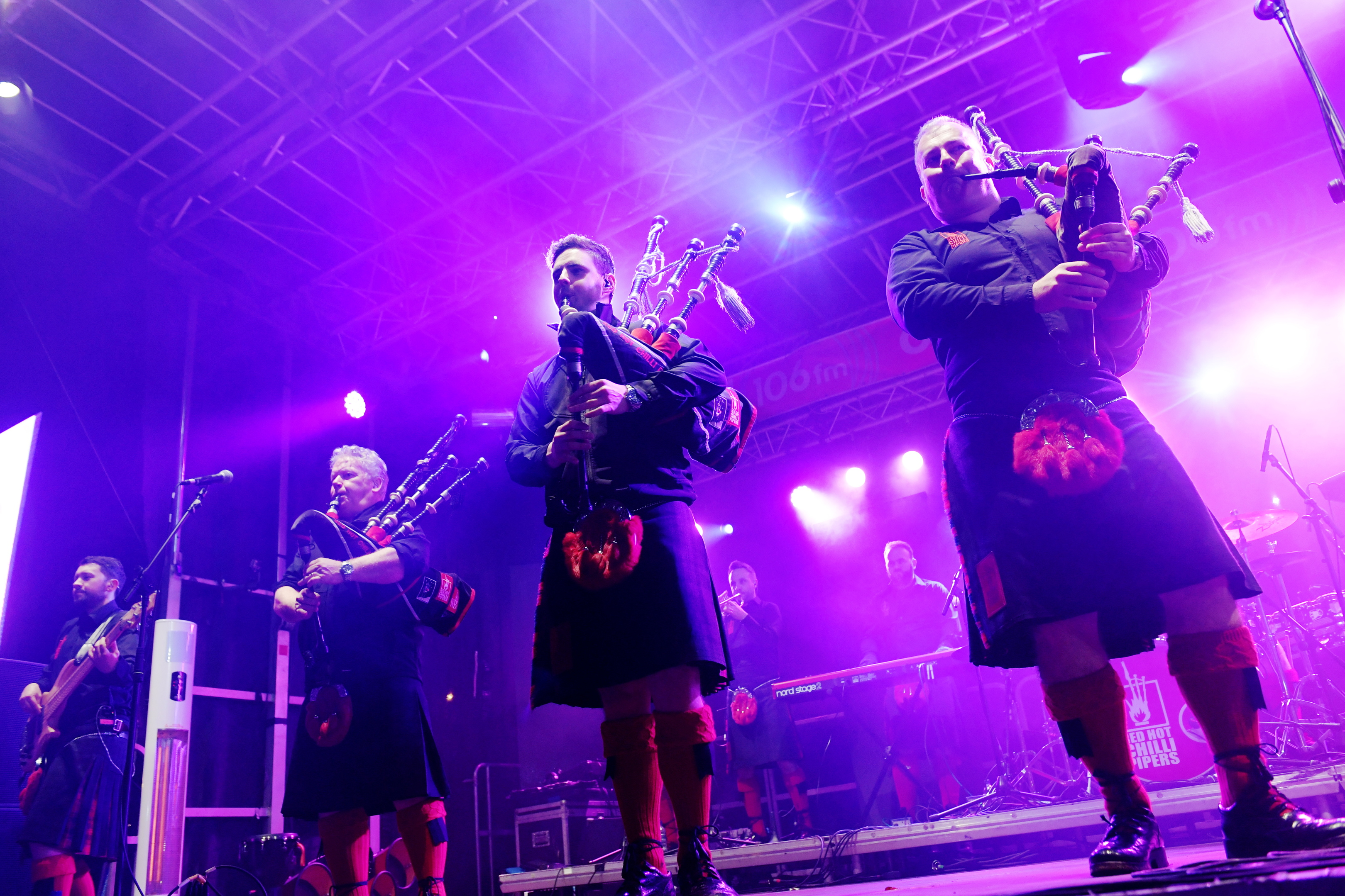 The Red Hot Chilli Pipers perform.