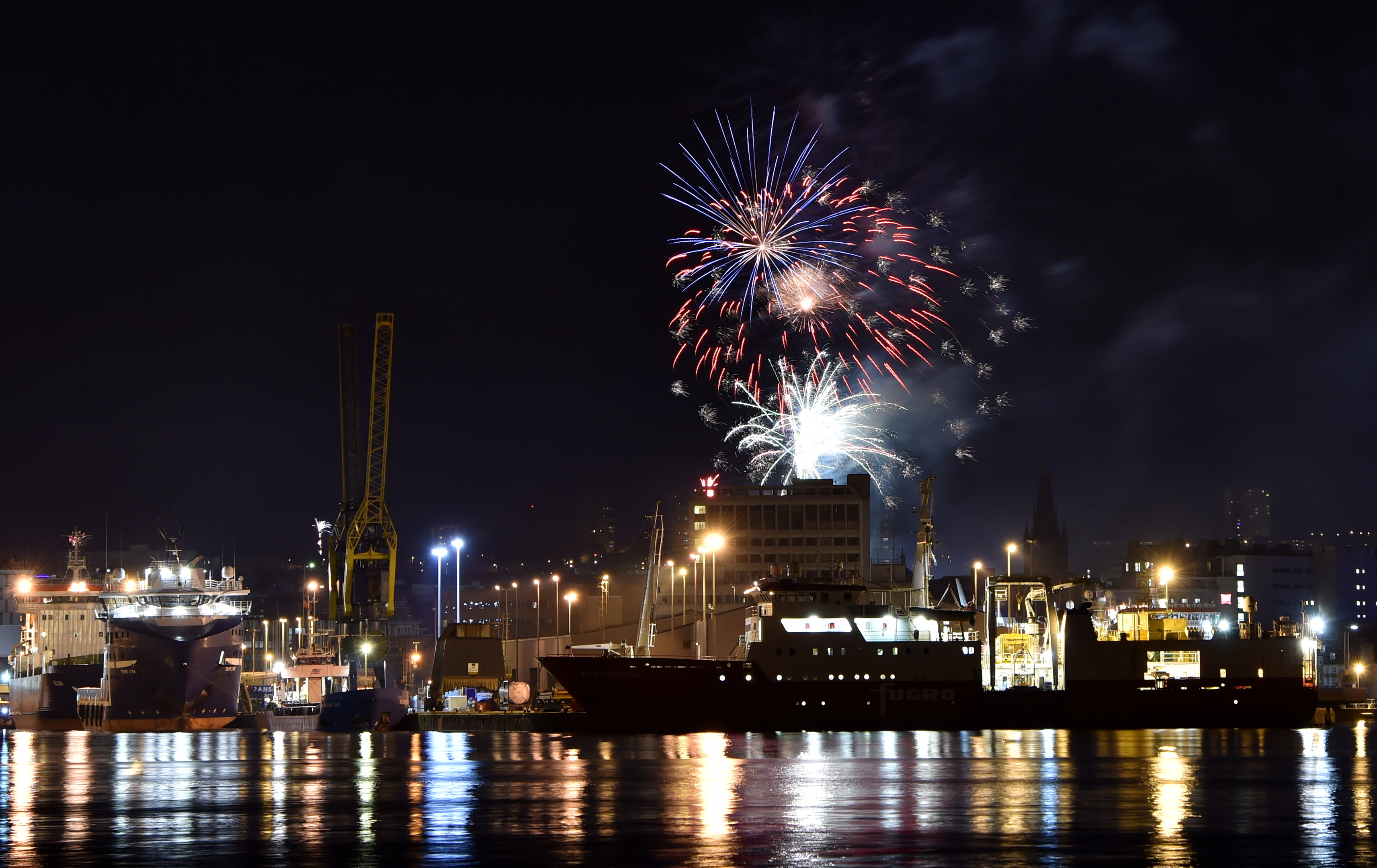 Fireworks over Aberdeen as viewed from the harbour