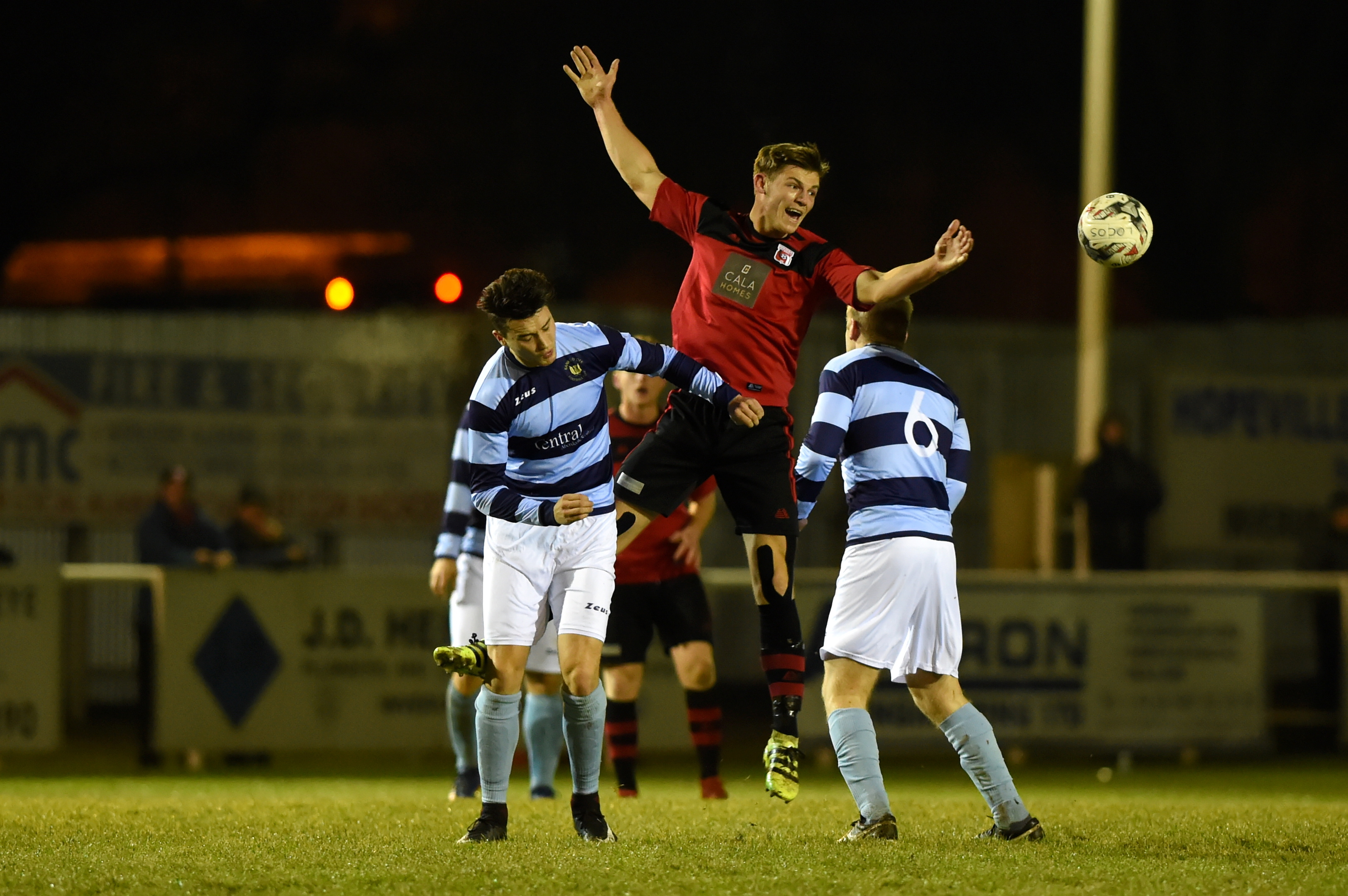 Andy Hunter, centre, in action against Banks o' Dee midweek.