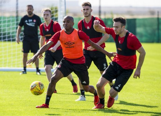 Chidi Nwakali (left) with Andrew Considine during the warm weather training camp in Dubai.